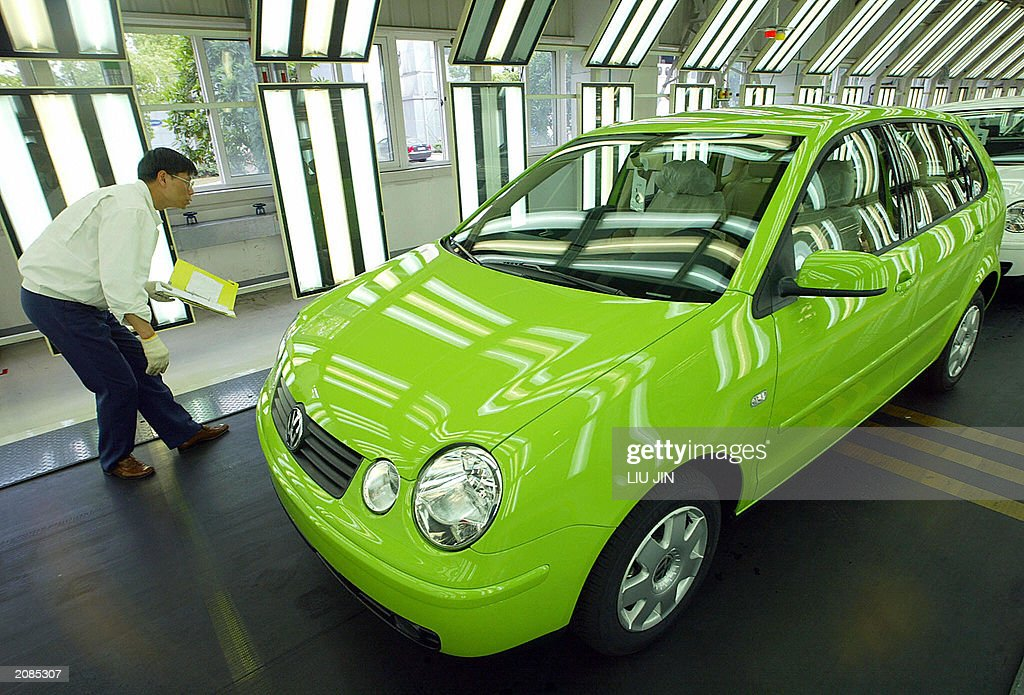 An engineer inspects a Polo car at a pro : News Photo