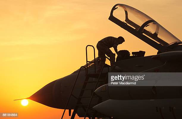 An engineer looks in the cockpit of a Royal Air Force Tornado GR4 fighter bomber as he prepares it for return to the United Kingdom on June 3 2009 at...