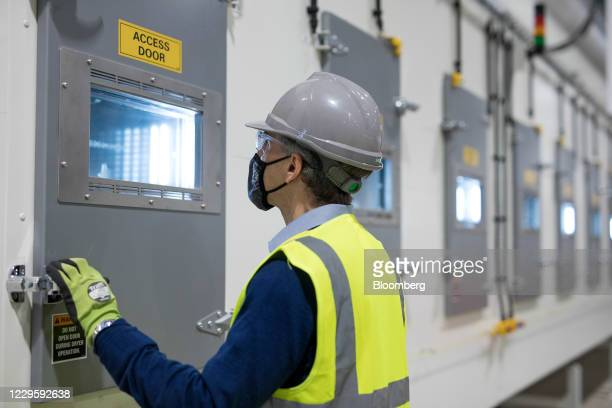 An engineer looks into an electrode drying oven at the U.K. Battery Industrialization Centre in Coventry, U.K. On Monday, Nov. 9, 2020. The Centre is...