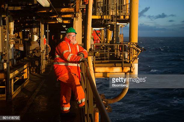 An engineer looks out to the sea from the well deck of the Armada gas condensate platform operated by BG Group Plc in the North Sea off the coast of...