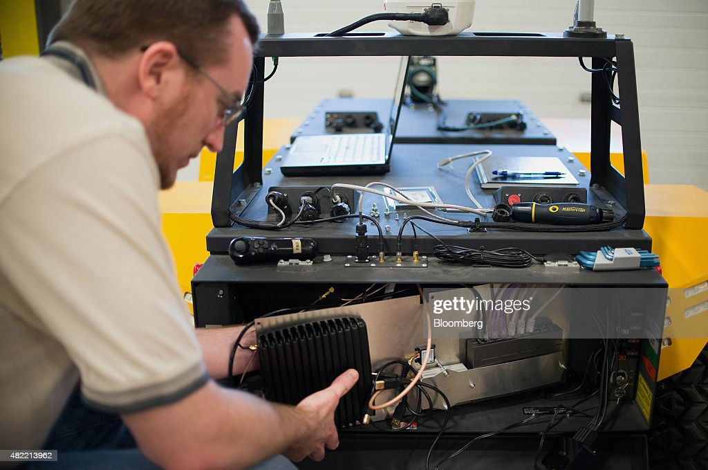 An engineer makes adjustments on Grizzly, the company's largest robot, at the Clearpath Robotics Inc. facility in Kitchener, Ontario, Canada, on Friday, July 24, 2015. Clearpath Robotics, Inc. manufactures industrial robot research and development applications in addition to offering guidance, navigation, control, perception, military engineers, educational mobile robots, hardware components, and computer scientists. Photographer: James MacDonald/Bloomberg via Getty Images