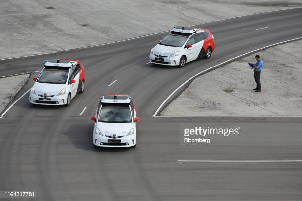 An engineer monitors information from driverless Toyota Motor Corp Prius hybrid cars operated by YandexTaxi part of YandexNV during a selfdriving...