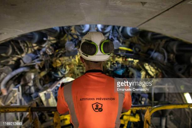 An engineer observes the head of the TBM called Federica at the construction site for the boring of the main tunnel of the Turin-Lyon high-speed...