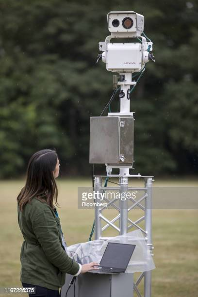 An engineer operates a Gas Cloud Imaging camera developed by Rebellion Photonics Inc at a BP Plc immersive technology event at the company's...