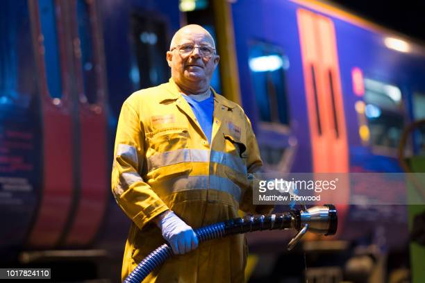 An engineer poses for a portrait while at work refuelling a train at the Arriva Trains Wales Canton Diesel Depot in Leckwith on September 12 2016 in...