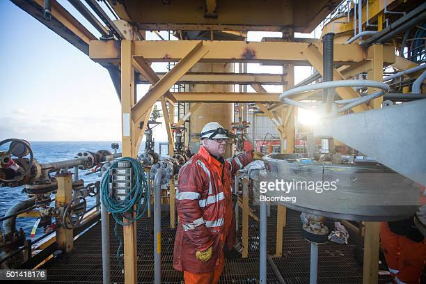 An engineer prepares to fix a pig launcher on the Armada gas condensate platform operated by BG Group Plc in the North Sea off the coast of Aberdeen...