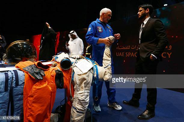 An engineer presents a set of clothes astronauts wear during the presentation of the UAE Space Agency's strategic frameworks on May 25 2015 at the...