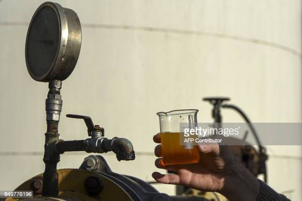 An engineer shows a sample of biodiesel at the industrial complex of the Louis Dreyfus Company in General Lagos Santa Fe province Argentina on...