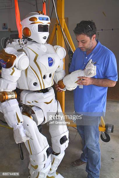 An engineer testing a robot at the DARPA Robotics Challenge Trials