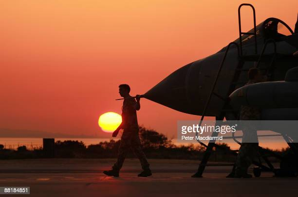 An engineer touches the nose cone of a Royal Air Force Tornado GR4 fighter bomber as he prepares it for return to the United Kingdom on June 3 2009...
