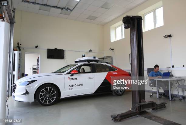 An engineer uses a laptop to monitor diagnostics from a Hyundai Motor Co Sonata vehicle operated by YandexTaxi part of YandexNV during a selfdriving...