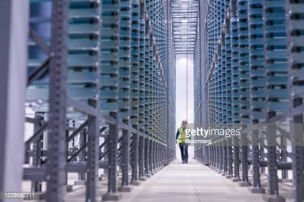 An engineer walks through the formation ageing area at the U.K. Battery Industrialization Centre in Coventry, U.K. On Monday, Nov. 9, 2020. The...