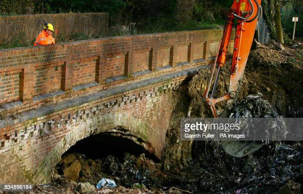 An engineer watches a digger excavate thousands of tonnes of waste dumped in the 1960's within the Imberhorne Cutting East Sussex as the Bluebell...