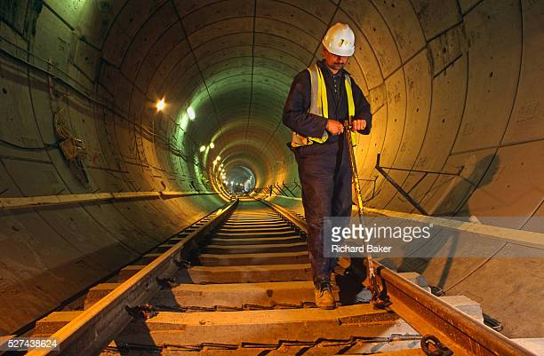 An engineer working underground during construction of the Heathrow Express train project on behalf of Heathrow airport operator BAA London England...