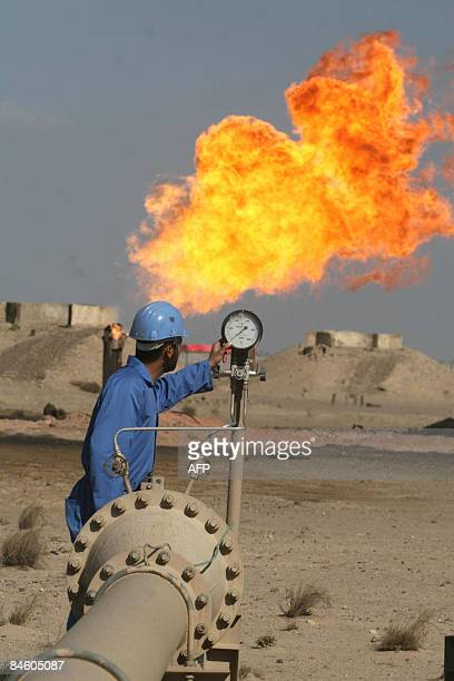 MORGAN An engineer works at the Barjisiya oil fields in Zubair One south west of the city of Basra 550 kms from Baghdad on February 3 2009 Plans to...