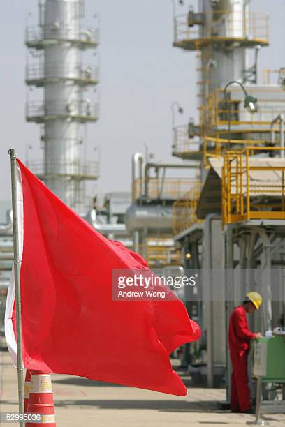 An engineer works at the Changqing Oil and Natural Gas Purification Plant on May 27 2005 in Jingbian county in western China's Shaanxi province Under...