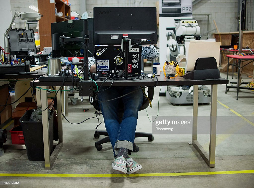 An engineer works on a computer at the Clearpath Robotics Inc. facility in Kitchener, Ontario, Canada, on Friday, July 24, 2015. Clearpath Robotics, Inc. manufactures industrial robot research and development applications in addition to offering guidance, navigation, control, perception, military engineers, educational mobile robots, hardware components, and computer scientists. Photographer: James MacDonald/Bloomberg via Getty Images