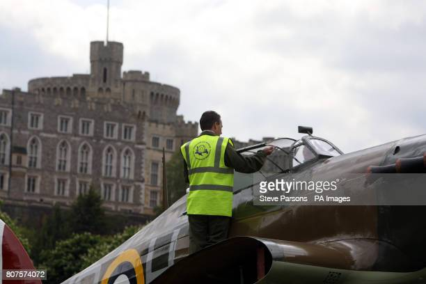 An engineer works on a replica of Sir Sydney Camm's Hawker Hurricane after it was lowered into place in the grounds of Windsor Castle in Berkshire as...