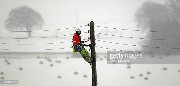 An engineer works on power lines near Auchterarder on February 26, 2010 in Auchtrerarder, Scotland. Homes in Scotland were left without power when...