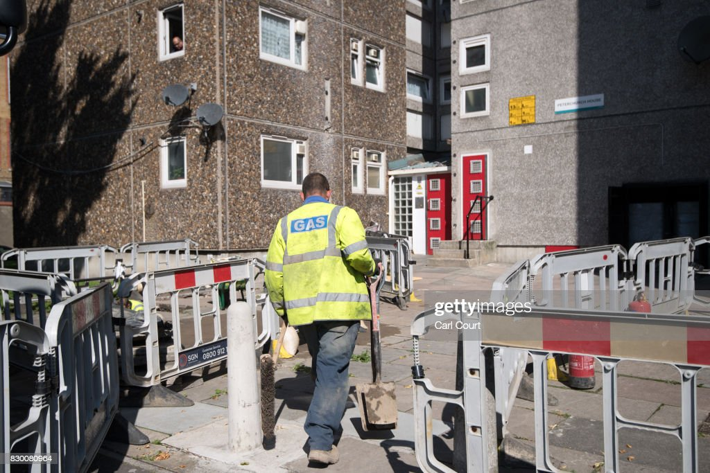 An engineer works to disconnect the gas supply on the Ledbury Estate on August 11, 2017 in London, England. Hundreds of residents of the estate are to be evacuated from four tower blocks over safety fears after a survey, ordered after the Grenfell Tower fire, found cracks in the walls leaving it vulnerable to collapse in the event of a gas explosion.