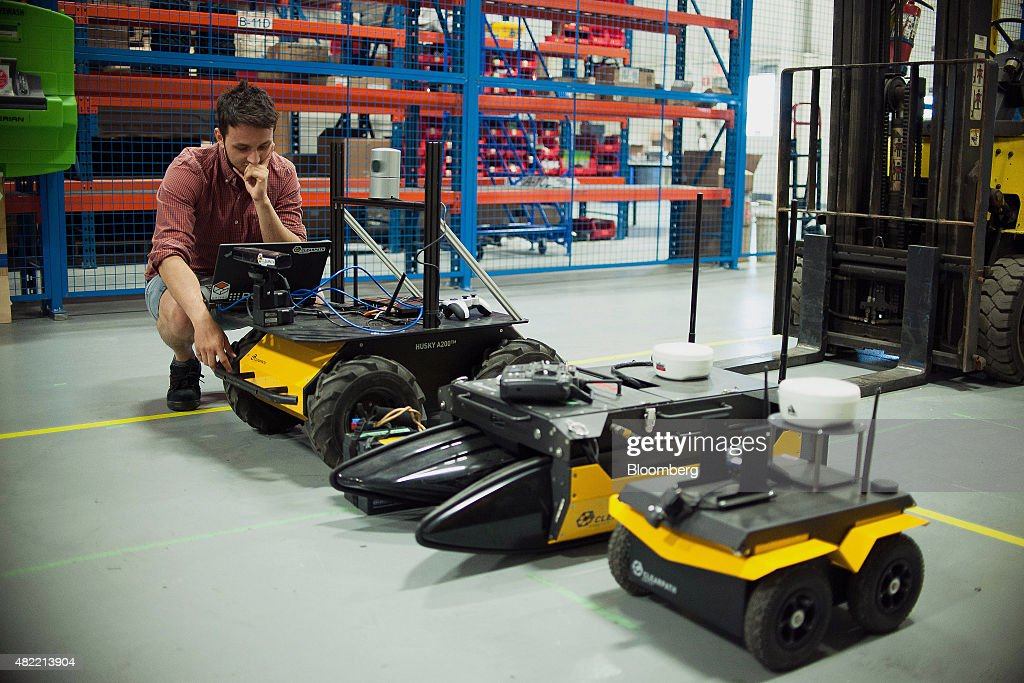 An engineer works with the Husky, Kingfisher, and Jackal robots at the Clearpath Robotics Inc. facility in Kitchener, Ontario, Canada, on Friday, July 24, 2015. Clearpath Robotics, Inc. manufactures industrial robot research and development applications in addition to offering guidance, navigation, control, perception, military engineers, educational mobile robots, hardware components, and computer scientists. Photographer: James MacDonald/Bloomberg via Getty Images