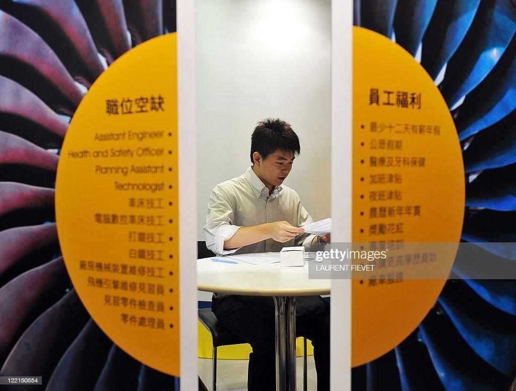 An engineering job seeker fills in an ap pictures getty images an engineering job seeker fills in an application form during the hong kong international airport job falaconquin