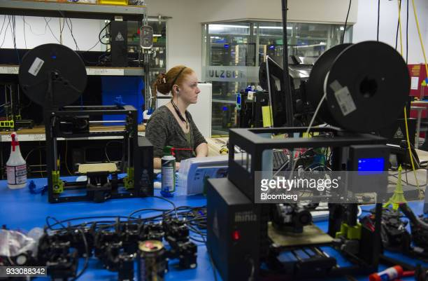 An engineering technician sits in front of a computer at the research and development department of the Aleph Objects Inc LulzBot 3D printers...