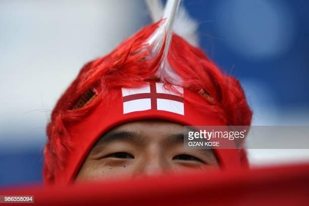 An England fan awaits the Russia 2018 World Cup Group G football match between England and Belgium at the Kaliningrad Stadium in Kaliningrad on June...