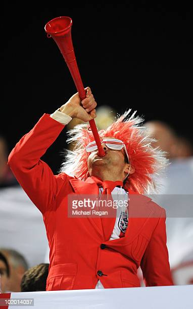 An England fan blows a vuvuzela prior to the 2010 FIFA World Cup South Africa Group C match between England and USA at the Royal Bafokeng Stadium on...