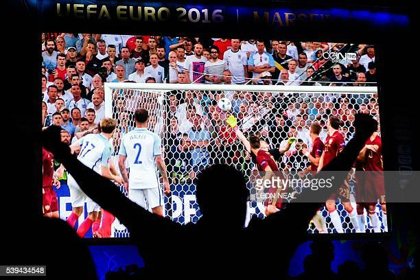 TOPSHOT An England fan celebrates in the fanzone in Marseille after England's midfielder Eric Dier scored during the Euro 2016 group B football match...