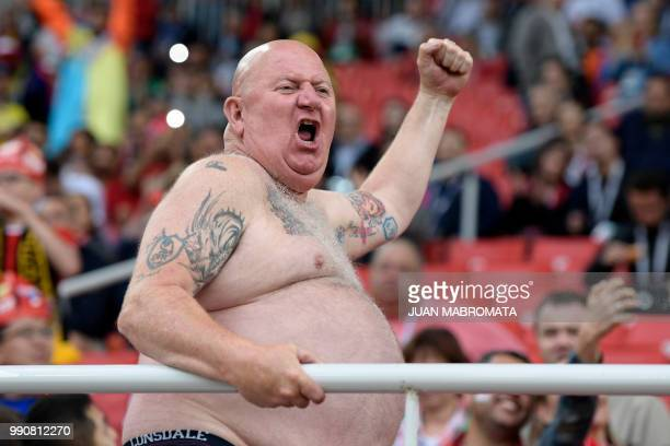 An England fan cheers before the Russia 2018 World Cup round of 16 football match between Colombia and England at the Spartak Stadium in Moscow on...