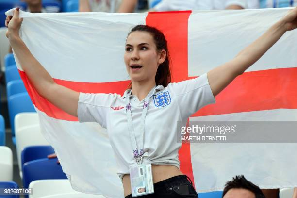 An England fan cheers during the Russia 2018 World Cup Group G football match between England and Panama at the Nizhny Novgorod Stadium in Nizhny...