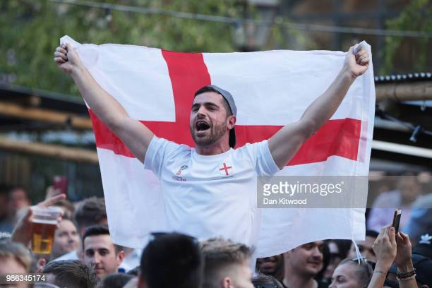 An England fan cheers on his team as football fans watch the 2018 FIFA World Cup Russia group G match between England and Belgium at Flat Iron Square...
