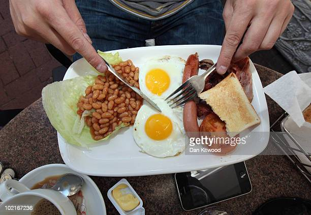 An England fan eats an full English breakfast on June 17 2010 in Cape Town South Africa Cape Town hosts the match between England and Algeria in the...