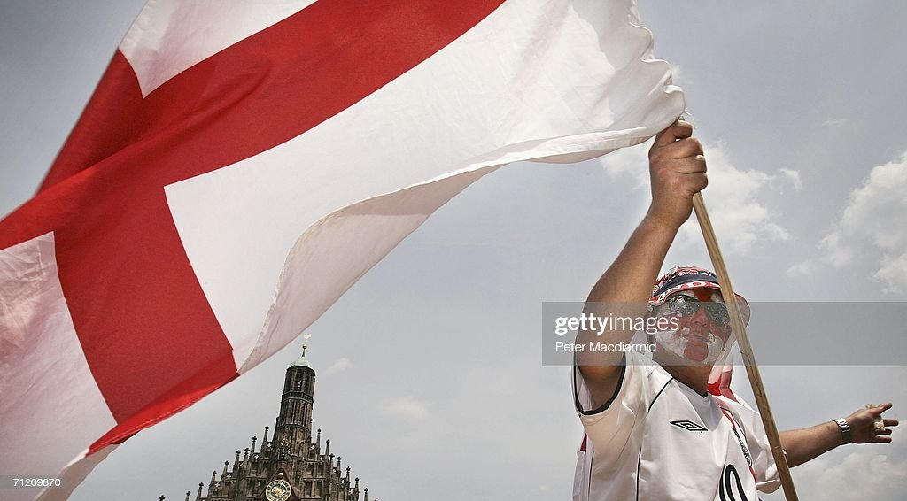 An England fan flies a St. George flag on June 15, 2006 in Nuremberg, Germany. England will face Trinidad and Tobago in their second group B match in Nuremberg today.
