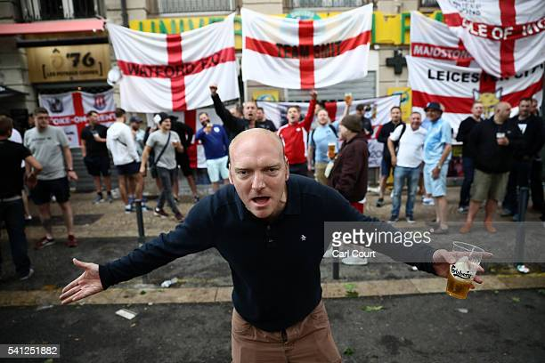 An England fan gestures as he drinks with other fans ahead of tomorrow's England v Slovakia Euro 2016 Group B match on June 19 2016 in SaintEtienne...