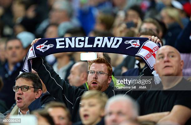 An England fan holds up a scarf before the UEFA EURO 2016 Qualifier match between England and Estonia at Wembley Stadium on October 9 2015 in London...