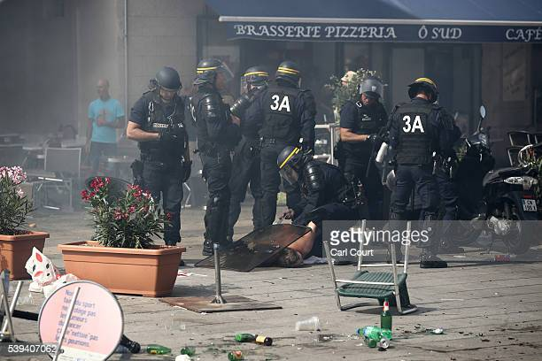 An England fan is arrested by the police after clashes ahead of the game against Russia later today on June 11 2016 in Marseille France Football fans...
