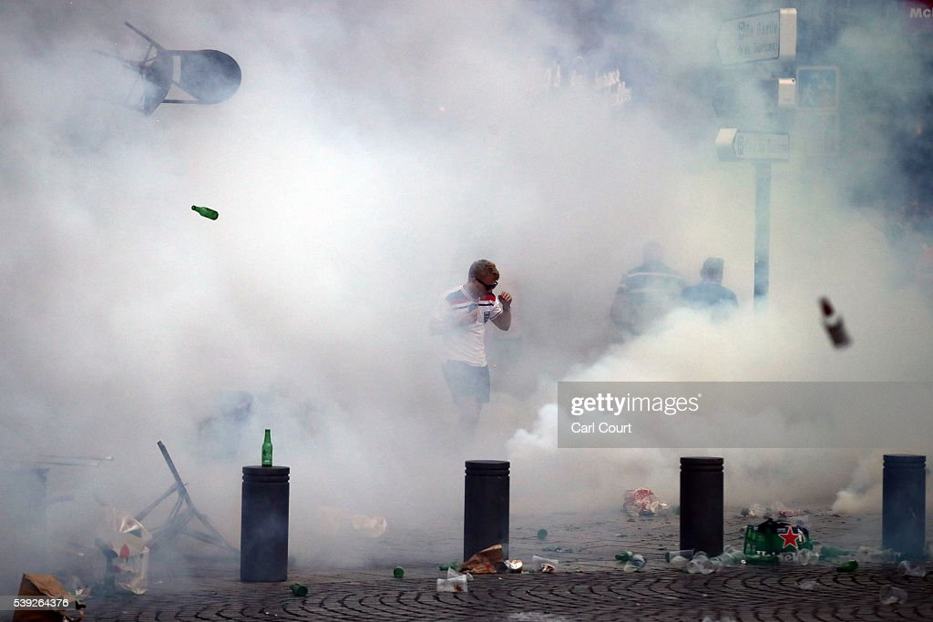 An England fan is surrounded by tear gas during a clash in Marseille ahead of the opening game of the UEFA Euro 2016 tournament later today, on June 10, 2016 in Marseille, France. Football fans from around Europe have descended on France for the UEFA Euro 2016 football tournament.