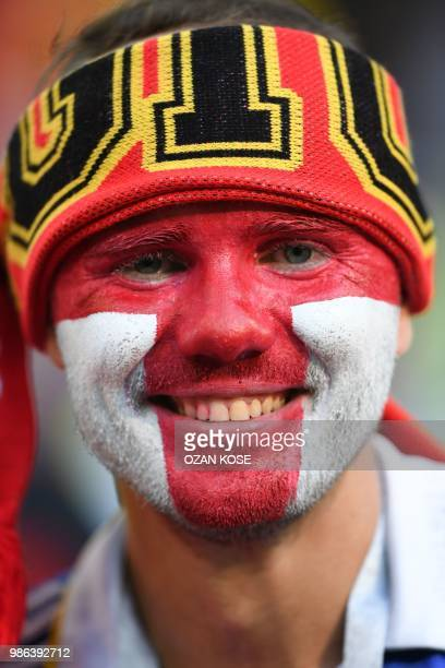An England fan poses before the Russia 2018 World Cup Group G football match between England and Belgium at the Kaliningrad Stadium in Kaliningrad on...