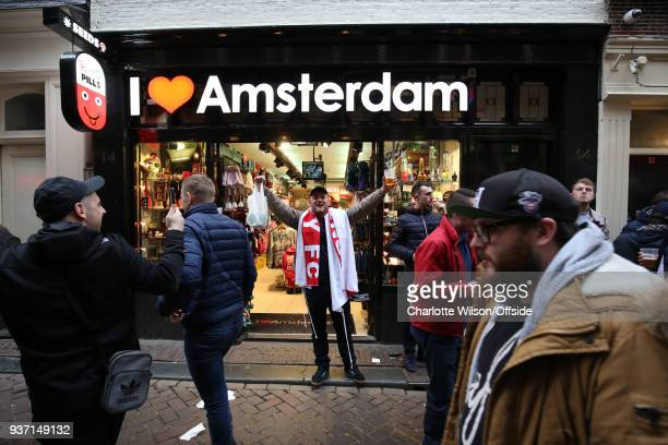 An England fan poses in the doorway of a shop called I Love Amsterdam ahead of the International Friendly match between Netherland and England at...