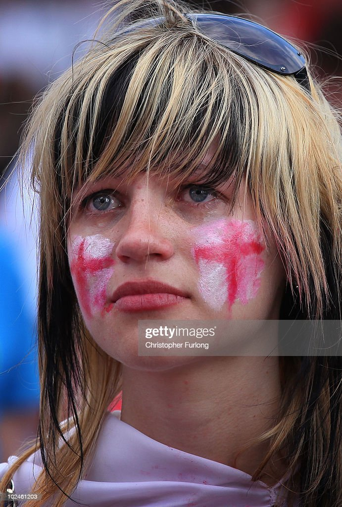 An England fan reacts as she watches England lose 4-1 to Germany on a giant screen in the Manchester fan zone on June 27, 2010 in Manchester, England. England were knocked out of the FIFA 2010 World Cup competition by 4 goals to 1 in South Africa