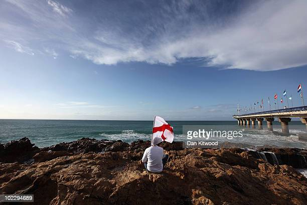 An England fan sits on rocks on the beach on June 22 2010 in Port Elizabeth South Africa England play Slovenia at the Nelson Mandela Bay Stadium...