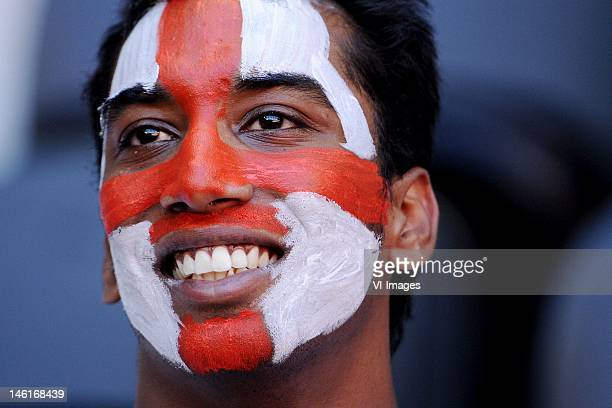 An England fan soaks up the atmopshere ahead of the UEFA EURO 2012 group D match between France and England at Donbass Arena on June 11 2012 in...