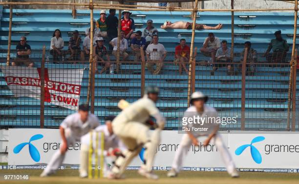 An England fan takes time to catch up on his sleep as play continues during day four of the 1st Test match between Bangladesh and England at Jahur...