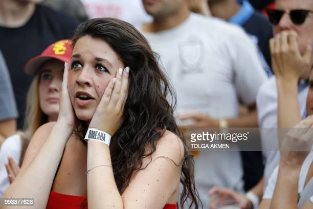 An England fan watches the Russia 2018 World Cup quarterfinal football match between Sweden and England on a big screen in London on July 7 2018