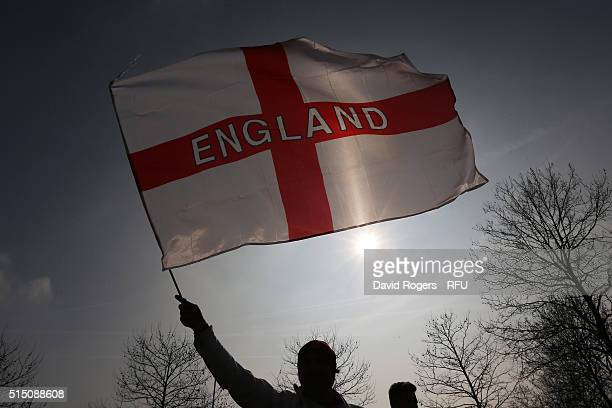 An England fan waves a flag prior to the RBS Six Nations match between England and Wales at Twickenham Stadium on March 12 2016 in London England