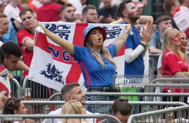 An England fan with a flag reacts to the UEFA Euro 2020 Championship Final between Italy and England, at the 4TheFans fan zone at Event City on July...