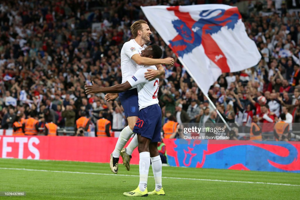 An England flag is waved behind Danny Welbeck of England as he celebrates scoring their 2nd goal with Harry Kane before realising it has been disallowed during the UEFA Nations League A group four match between England and Spain at Wembley Stadium on September 8, 2018 in London, United Kingdom.