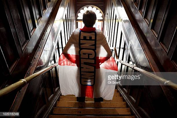 An England football fan arrives in a pub in Clapham as England prepare to begin their first game of the FIFA World Cup in South Africa on June 12,...